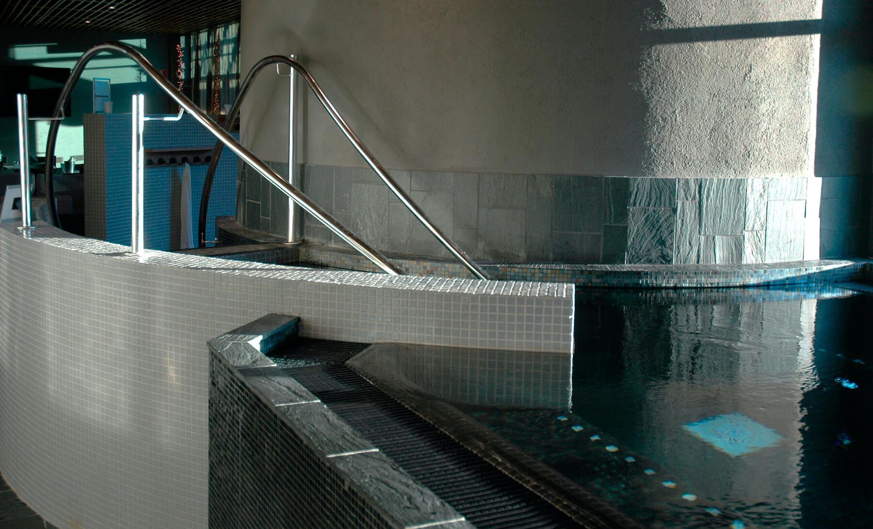 slate tiles by swimming pool