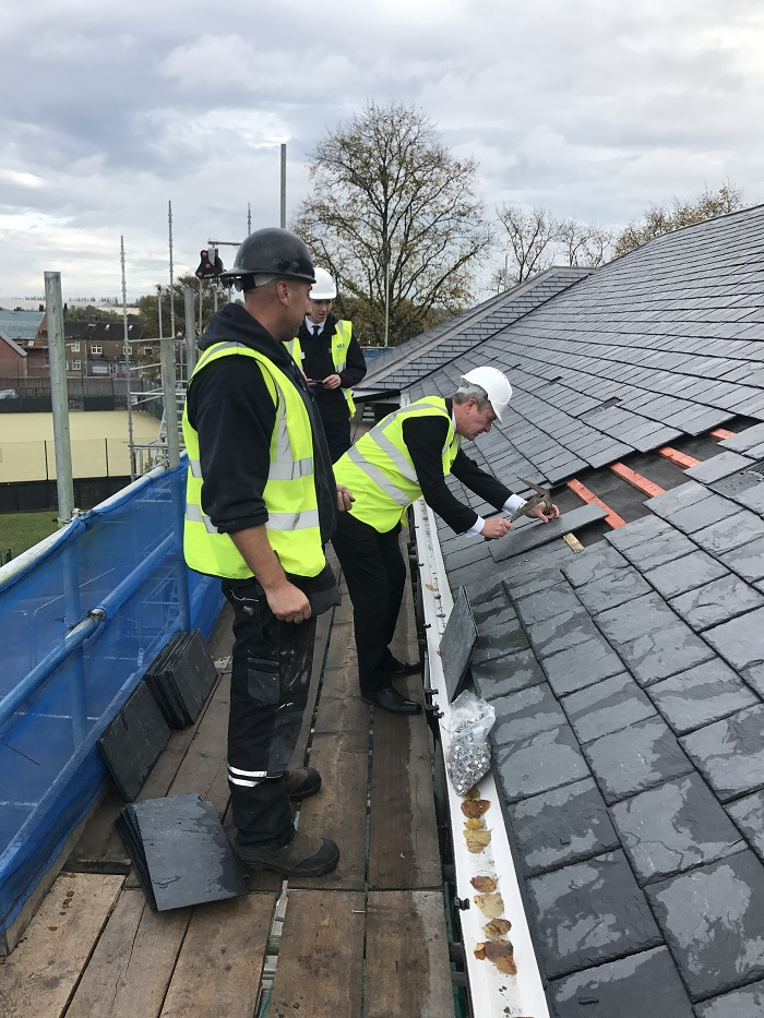 Slate roof being built